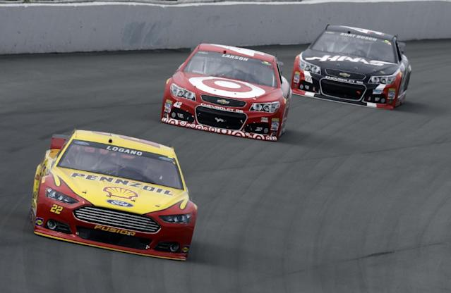 Joey Logano (22) leads Kyle Larson (42) and Kurt Busch (41) during the NASCAR Sprint Cup series auto race at Pocono Raceway, Sunday, Aug. 3, 2014, Long Pond, Pa. (AP Photo/Mel Evans)