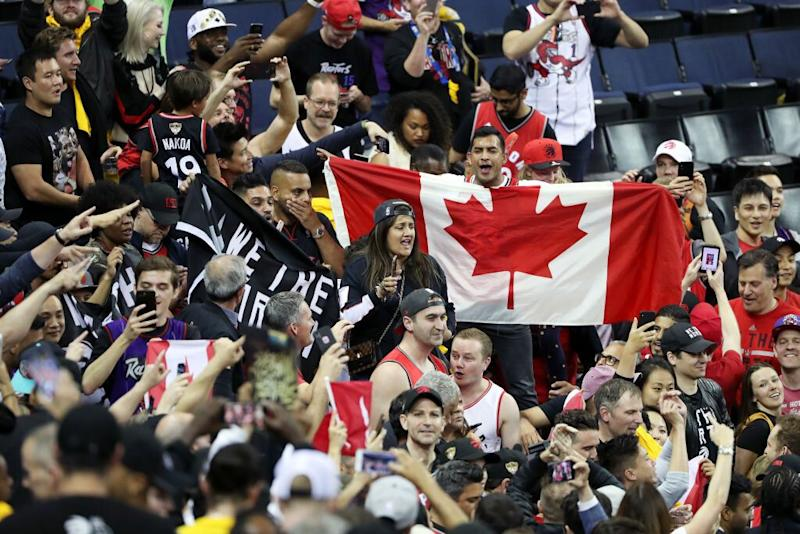Hundreds, if not thousands, of Raptors fans surrounded the Oracle Arena court after Game 4. (Getty Images)