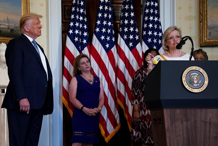 Cleta Mitchell, attorney and former member of the Oklahoma House of Representatives, speaks at the White House in Washington, Aug. 18, 2020, as President Donald Trump looks on. (Anna Moneymaker/The New York Times)