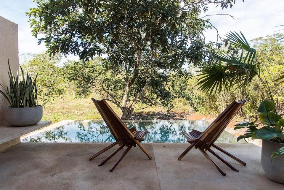 "<p>Located in the Yucatán's center and just 40 minutes from the ruins of Chichén Itzá, Valladolid is known for its stunning cenotes, or natural swimming pools. While this one-bedroom Airbnb is just across from Cenote Suytún, you can take a dip even closer to home in the private, man-made plunge pool. While the home is a vibrant pink on the outside, the inside is a neutral, natural oasis, from the living and dining rooms to the kitchen and the bedroom. What really catches our eye, though, is the bathroom's stunning, extra-large open-ceiling shower. (With that in mind, this is probably best for a couple.)</p> <p><strong>Book now:</strong> <a href=""https://airbnb.pvxt.net/EoYkX"" rel=""nofollow noopener"" target=""_blank"" data-ylk=""slk:From $92 per night, airbnb.com"" class=""link rapid-noclick-resp"">From $92 per night, airbnb.com</a></p>"