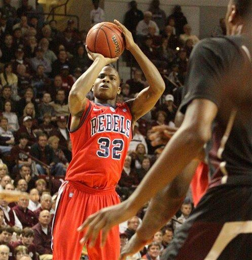 Mississippi's Jarvis Summers (32) shoots over Mississippi State defenders during the first half of their NCAA college basketball game in Starkville, Miss., Thursday, Feb. 9, 2012. (AP Photo Jim Lytle)