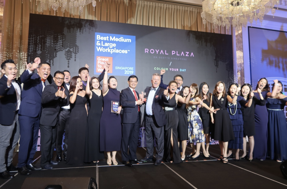 CEO Patrick Fiat with hotel talents receiving the award  from Guest of Honour, Mr Heng Swee Keat, Deputy Prime Minister. (PHOTO: Royal Plaza on Scotts)