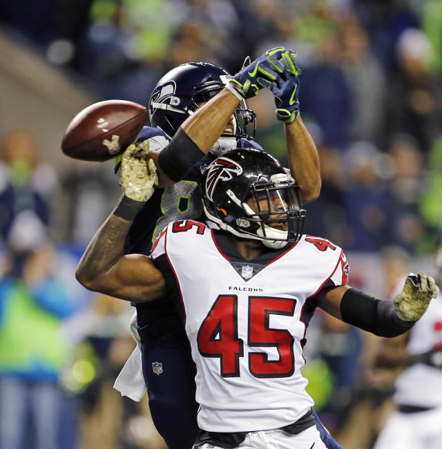 Seattle Seahawks' Doug Baldwin misses catching a pass as Atlanta Falcons' Deion Jones (45) defends in the first half of an NFL football game, Monday, Nov. 20, 2017, in Seattle. (AP Photo/Stephen Brashear)