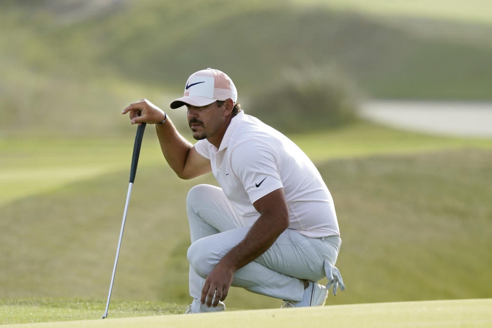 Brooks Koepka works on the 16th green during the third round at the PGA Championship golf tournament on the Ocean Course, Saturday, May 22, 2021, in Kiawah Island, S.C. (AP Photo/Matt York)