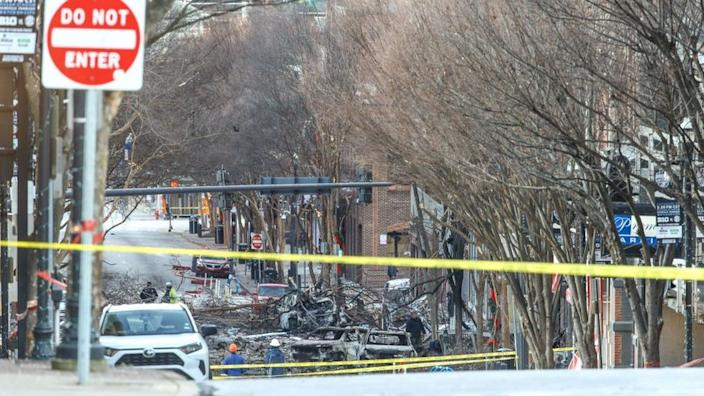 Police close off an area damaged by an explosion on Christmas morning
