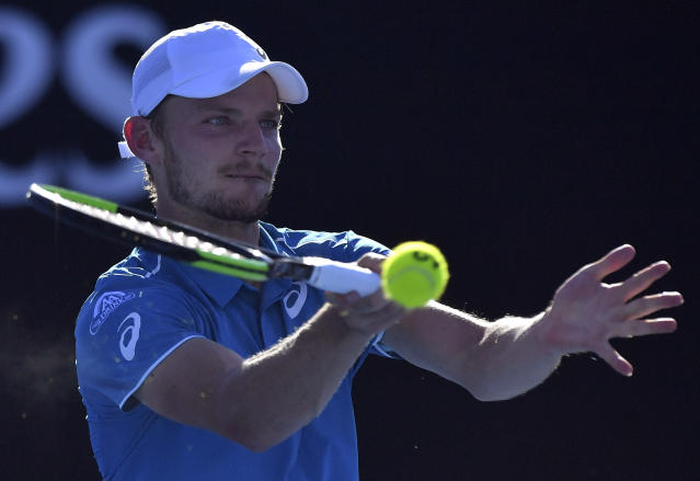 Belgium's David Goffin makes a forehand return to France's Julien Benneteau during their second round match at the Australian Open tennis championships in Melbourne, Australia, Thursday, Jan. 18, 2018. (AP Photo/Andy Brownbill)