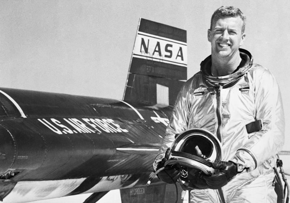 Test pilot Joseph A. Walker smiles as he stands beside an X-15 rocket plane in which he flew at a record breaking altitude of 165,000 feet and a speed of 2,590 miles an hour. California.