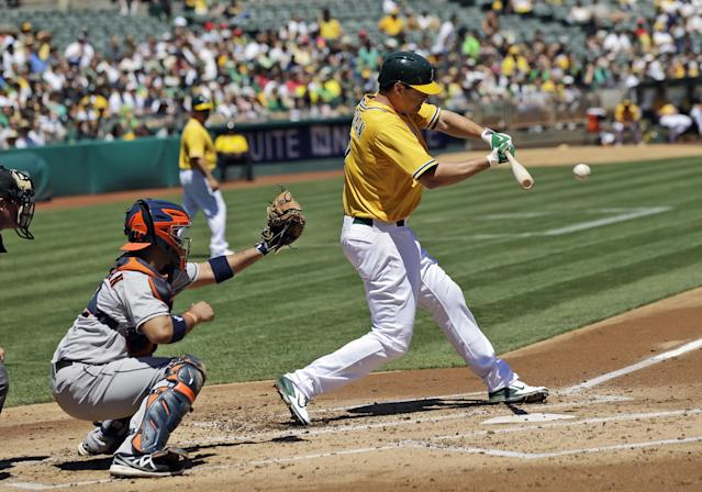 Oakland Athletics' Nate Freiman drives in two runs with a double against the Houston Astros during the first inning of a baseball game Thursday, Aug. 15, 2013, in Oakland, Calif. (AP Photo/Marcio Jose Sanchez)