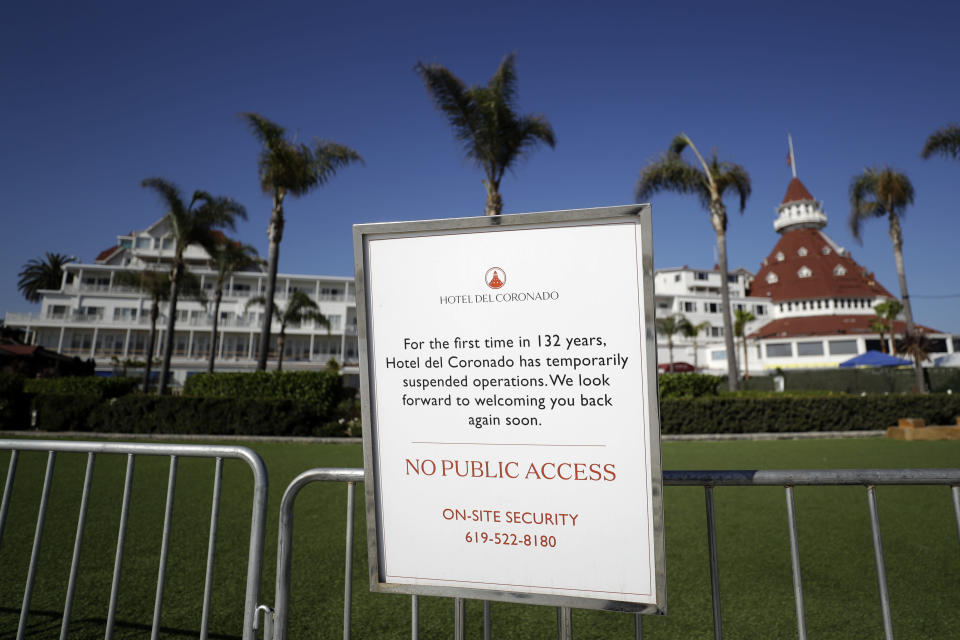 A sign is posted in front of the Hotel Del Coronado Thursday, June 11, 2020, in Coronado, Calif. California's tourism industry is gearing back up with the state giving counties the green light to allow hotels, zoos, aquariums, wine tasting rooms and museums to reopen Friday. (AP Photo/Gregory Bull)