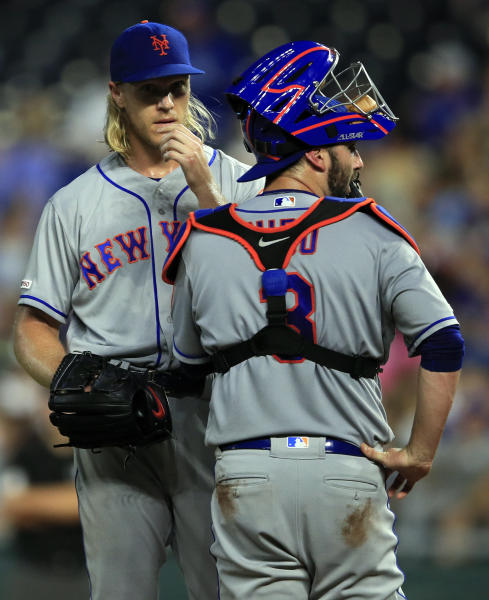 New York Mets starting pitcher Noah Syndergaard, left, talks with catcher Tomas Nido (3) after two runs scored in the fifth inning of a baseball game against the Kansas City Royals at Kauffman Stadium in Kansas City, Mo., Friday, Aug. 16, 2019. (AP Photo/Orlin Wagner)