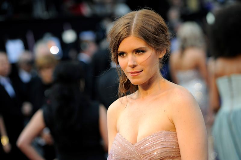 "FILE - In this Sunday, Feb. 26, 2012 file photo, Kate Mara arrives before the 84th Academy Awards, in the Hollywood section of Los Angeles. ""House of Cards"" actress Mara won't be announcing the 2013 Emmy nominations Thursday morning, July 18, 2013. The Academy of Television Arts and Sciences said Mara's plane had a mechanical malfunction and couldn't take off from Santa Fe, where she is on location. (AP Photo/Chris Pizzello, File)"