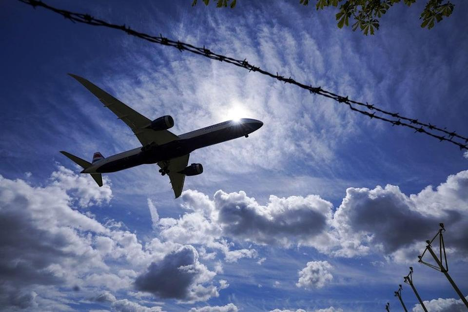 A plane lands on the southern runway at London Heathrow Airport. (Steve Parsons/PA) (PA Wire)