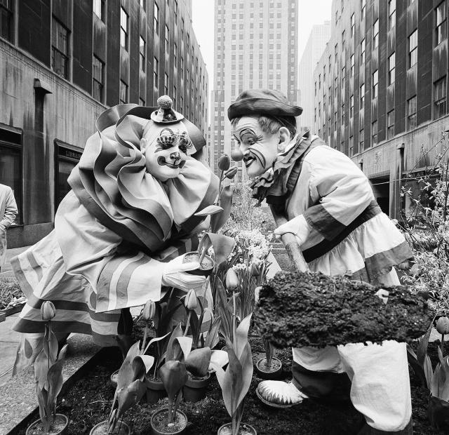 <p>Clowns from the Ringling Brothers Barnum & Bailey Circus, Blinko, left, and Frankie Saluto, right, lend a hand in planting tulips and other flowers in the Channel Gardens of Rockefeller Center in New York, April 7, 1960. The Spring Bulb Show is the first floral displays to be placed in the gardens that are just off Fifth Avenue. (AP Photo/Hans Von Nolde) </p>