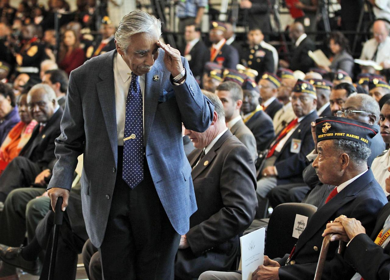 Rep. Charles Rangel, D-N.Y., salutes surviving members of the Montford Point Marines, during a Congressional Gold Medal ceremony at the U.S. Capitol in Washington, Wednesday, June 27, 2012. Montford Point Marines were the first African Americans to serve in the Marines and almost 400 attended the ceremony. Nearly 20,000 African Americans trained at the segregated Montford Point in Camp Lejeune, N.C. (AP Photo/Pablo Martinez Monsivais)