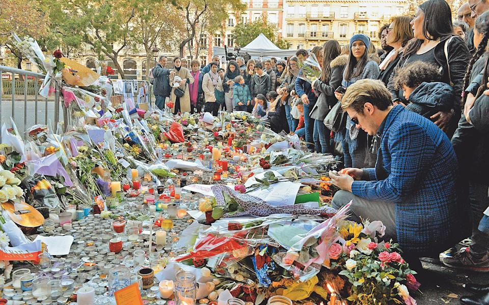 Mourners gather near the scene - AFP via Getty Images