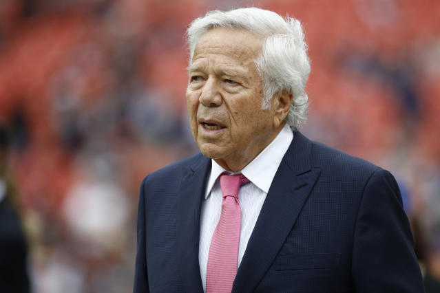 FILE - In this Oct. 6, 2019, file photo, New England Patriots owner Robert Kraft walks the turf ahead of an NFL football game between the Washington Redskins and the New England Patriots in Landover, Md. The Patriots say team owner Robert Krafts family is pledging $1 million to local grassroots organizations to promote social justice. The team says the money will be distributed over the next 10 months in $100,000 monthly donations to recipients chosen in collaboration with Patriots players. (AP Photo/Patrick Semansky, FIle)