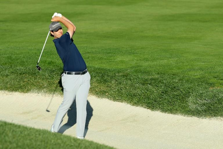 Beau Hossler of the US plays his shot from a bunker on the second hole during round one of the AT&T Pebble Beach Pro-Am, at Pebble Beach Golf Links in California, on February 8, 2018