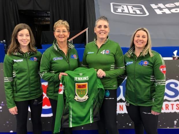Members of Team Sherry Anderson with Aly Jenkins' jersey. Left to right, Breanne Knap, Sherry Anderson, Nancy Martin and Chaelynn Kitz.