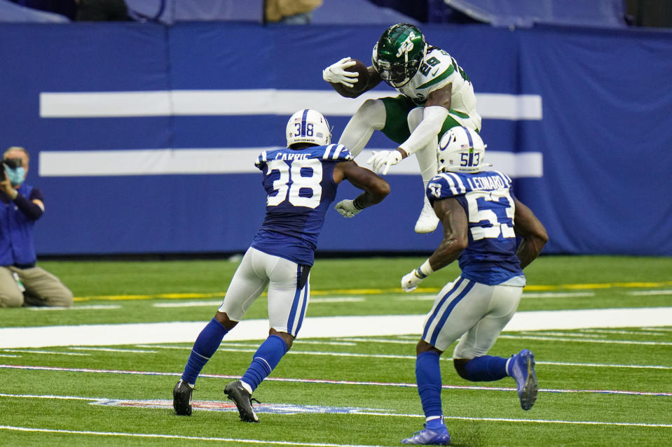 New York Jets running back Kalen Ballage (29) tries to leap over Indianapolis Colts running back Jonathan Taylor (28) and outside linebacker Darius Leonard (53) in the second half of an NFL football game in Indianapolis, Sunday, Sept. 27, 2020. (AP Photo/AJ Mast)