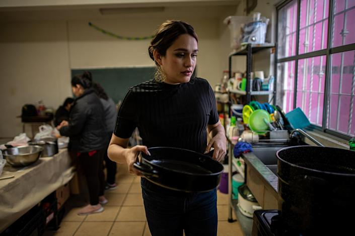 "Shelter coordinator Karina Breceda cooks soup with migrant women in the kitchen. ""When I see my team, they're basically on call 24/7,"" Breceda says. ""There's a lot of peace, and a lot of healing with the work that they're doing.""<span class=""copyright"">Meridith Kohut for TIME</span>"