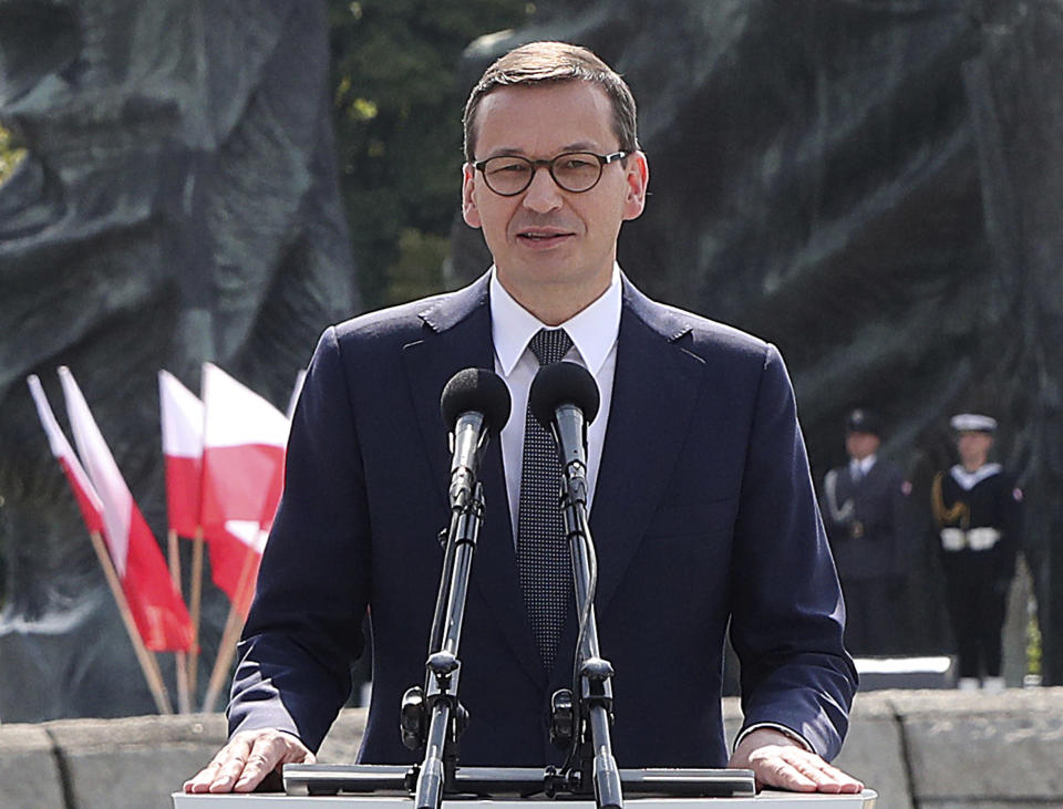 In this Aug. 15, 2019 photo, Poland's Prime Minister Mateusz Morawiecki is speaking during national observances of the Armed Forces Day in Katowice, Poland. On Tuesday Morawiecki demanded explanations from the justice minister after allegations surfaced the minister's deputy encouraged an online hate campaign against judges critical of the government. (AP Photo/Czarek Sokolowski)