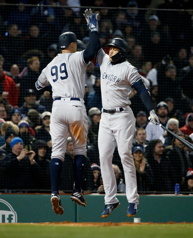 New York Yankees' Aaron Judge (99) celebrates his solo home run with Giancarlo Stanton during the fifth inning of a baseball game against the Boston Red Sox in Boston, Tuesday, April 10, 2018. (AP Photo/Michael Dwyer)