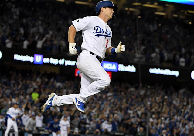 The Dodgers' Will Smith leaps in the air after just missing a home run against the Nationals in the ninth inning of Game 5 on Wednesday. (Photo by Keith Birmingham/MediaNews Group/Pasadena Star-News via Getty Images)