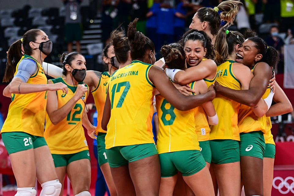 Brazil's players celebrate their victory in the women's quarter-final volleyball match between Brazil and Russia during the Tokyo 2020 Olympic Games at Ariake Arena in Tokyo on August 4, 2021. (Photo by PEDRO PARDO / AFP) (Photo by PEDRO PARDO/AFP via Getty Images)