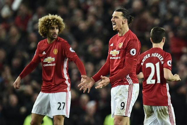 Manchester United's striker Zlatan Ibrahimovic (C) celebrates scoring his team's first goal with midfielder Marouane Fellaini (L) during the English Premier League football match against Liverpool January 15, 2017 (AFP Photo/Oli SCARFF )