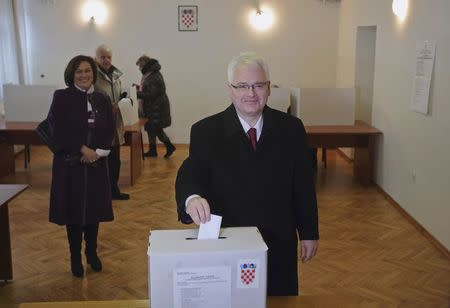 Croatian President Ivo Josipovic casts his vote at a polling booth during the presidential election in Zagreb