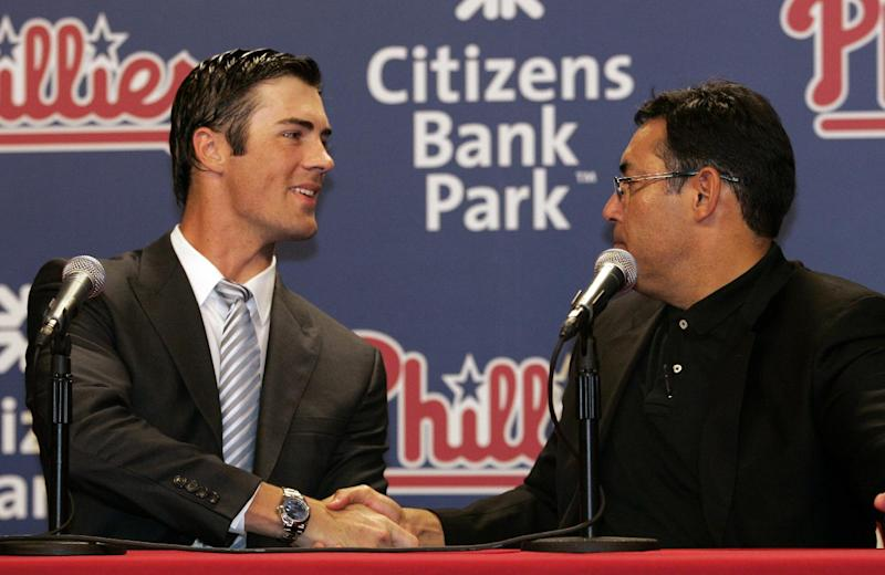 Philadelphia Phillies pitcher Cole Hamels, left, and general manager Ruben Amaro, Jr., shake hands during a news conference in Philadelphia, Wednesday, July 25, 2012. Hamels and the Phillies have agreed to a $144 million, six-year contract that prevents the 2008 World Series MVP from becoming a free agent after the season. (AP Photo/Tom Mihalek)