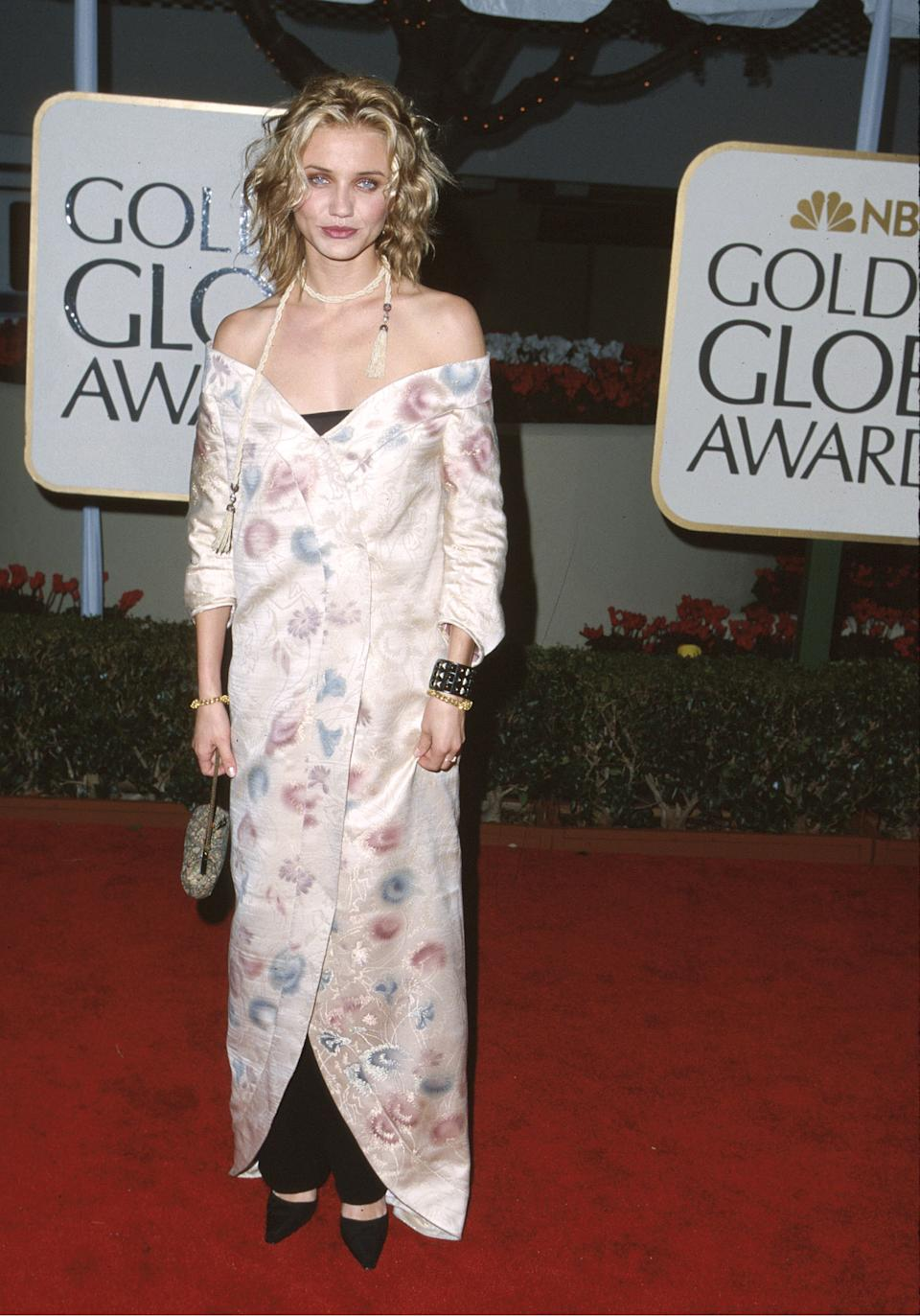 <p>In Cameron Diaz's defense, the late '90s were a weird time for fashion, so pairing a nightgown with office trousers and using a rope as a scarf seems very fitting. <em>(Image via Getty Images)</em></p>