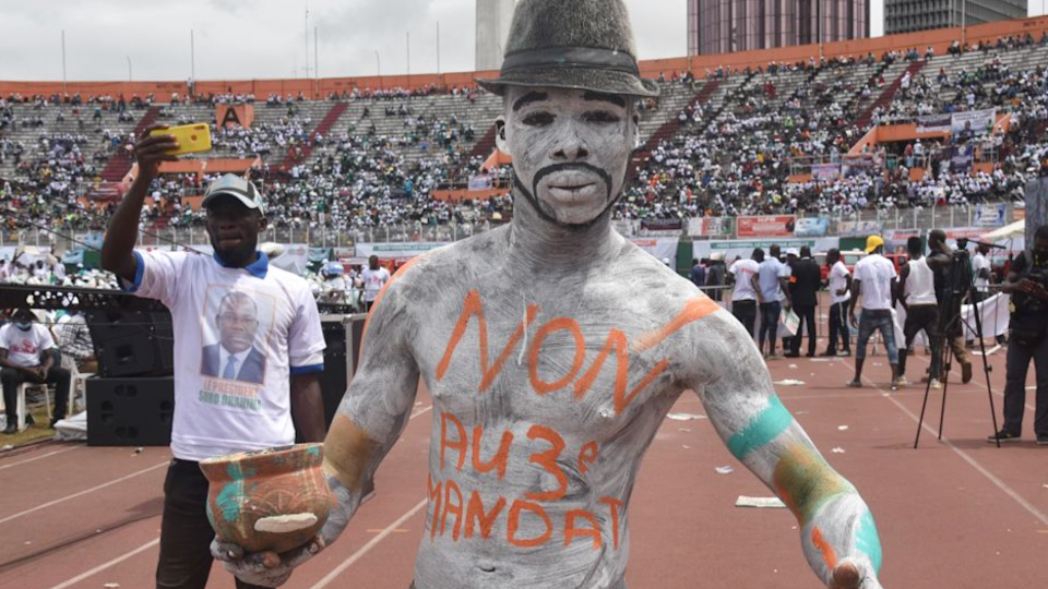 A man painted up at a rally against the candidacy of Alassane Ouattara at a stadium in Abidjan, Ivory coast