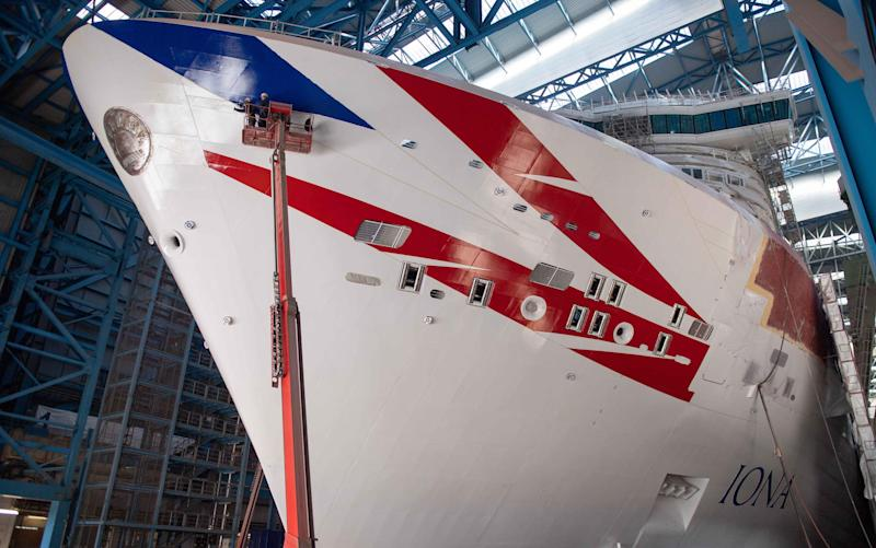 Work is carried out on bow of Iona in shipyard