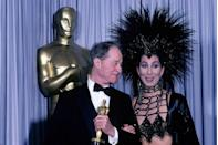 "<p>Cher was just a presenter, but she definitely stole the show in her Bob Mackie gown while giving the Best Supporting Actor award to Don Ameche for <em><a href=""https://www.amazon.com/Cocoon-Don-Ameche/dp/B01N3PMDJO/ref=sr_1_1?s=instant-video&ie=UTF8&qid=1547579922&sr=1-1&keywords=Cocoon&tag=syn-yahoo-20&ascsubtag=%5Bartid%7C10055.g.5132%5Bsrc%7Cyahoo-us"" rel=""nofollow noopener"" target=""_blank"" data-ylk=""slk:Cocoon"" class=""link rapid-noclick-resp"">Cocoon</a></em>.</p><p><strong>RELATED:</strong> <a href=""https://www.goodhousekeeping.com/health/diet-nutrition/a44341/what-cher-eats-in-a-day/"" rel=""nofollow noopener"" target=""_blank"" data-ylk=""slk:What Cher Actually Eats in a Day to Stay So Unbelievably Fit"" class=""link rapid-noclick-resp"">What Cher Actually Eats in a Day to Stay So Unbelievably Fit</a></p>"