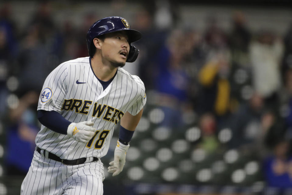Milwaukee Brewers' Keston Hiura watches after hitting an RBI-double during the second inning of a baseball game against the Pittsburgh Pirates, Saturday, April 17, 2021, in Milwaukee. (AP Photo/Aaron Gash)
