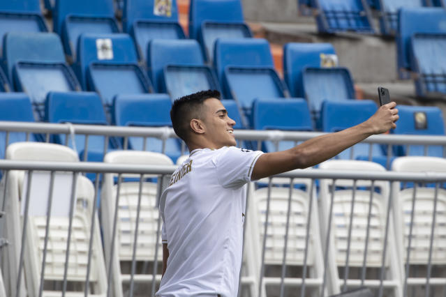 Brazilian player Rainier takes a selfie during his official presentation after signing for Real Madrid at the Santiago Bernabeu stadium in Madrid, Spain, Tuesday, Feb. 18, 2020. (AP Photo/Paul White)