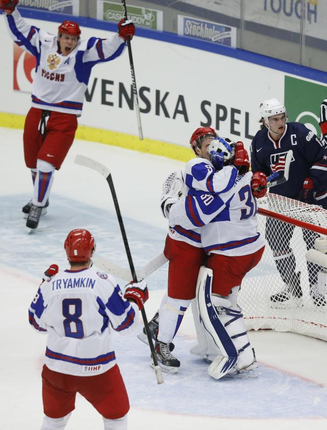 Russia's players Nikita Tryamkin (8), Andrei Mironov (L), Anton Slepyshev and goalie Andrei Vasilevski (30) celebrate their victory past Riley Barber of the U.S. (R) in their IIHF Ice Hockey World Championship quarter-final match in Malmo, Sweden, January 2, 2014. REUTERS/Alexander Demianchuk (SWEDEN - Tags: SPORT ICE HOCKEY)