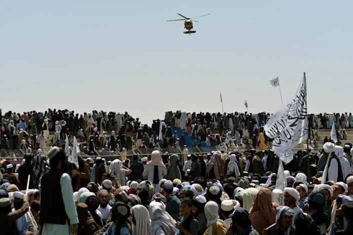 Taliban supporters gather to celebrate the US withdrawal of all its troops out of Afghanistan, in Kandahar on September 1, 2021 following the Talibans military takeover of the country.