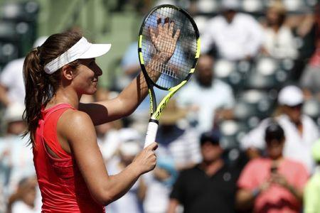 Mar 29, 2017; Miami, FL, USA; Johanna Konta of Great Britain salutes the crowd after her match against Simona Halep of Romania (not pictured) on day nine of the 2017 Miami Open at Crandon Park Tennis Center. Konta won 3-6, 7-6(7), 6-2. Geoff Burke-USA TODAY Sports