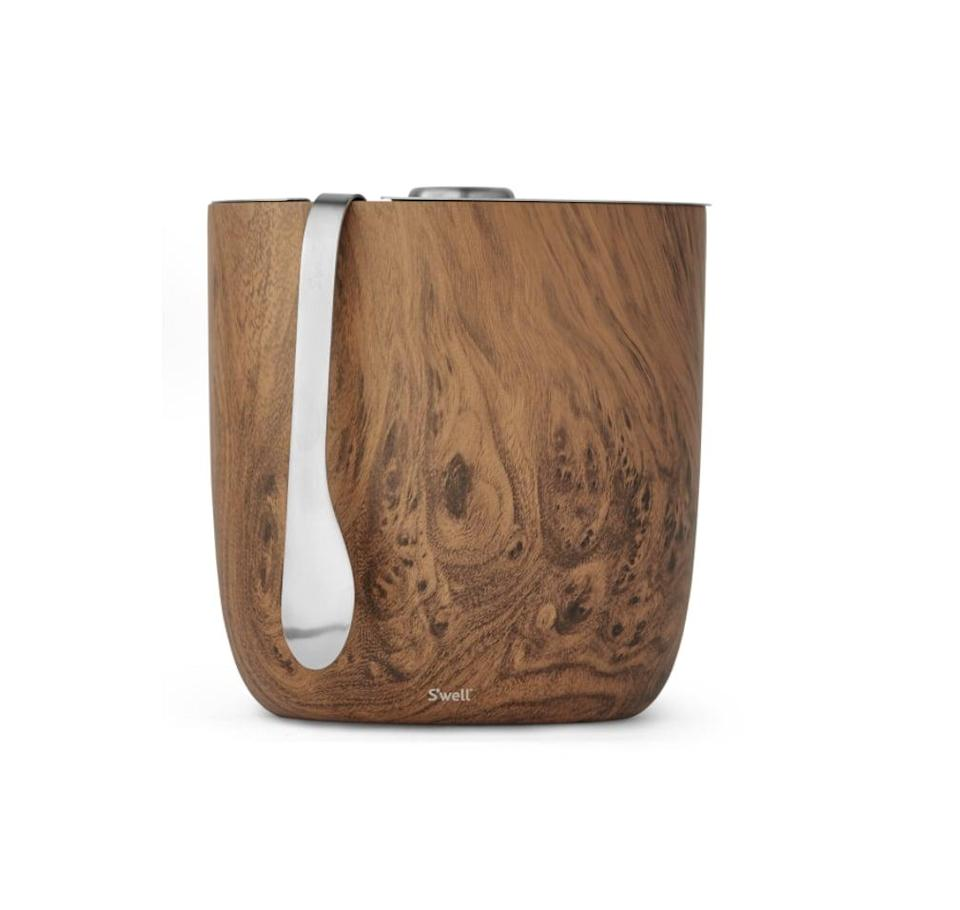 <p>For the chef who's always having dinner parties, they'll love this elegant <span>S'well Teakwood Ice Bucket + Tongs</span> ($50).</p>