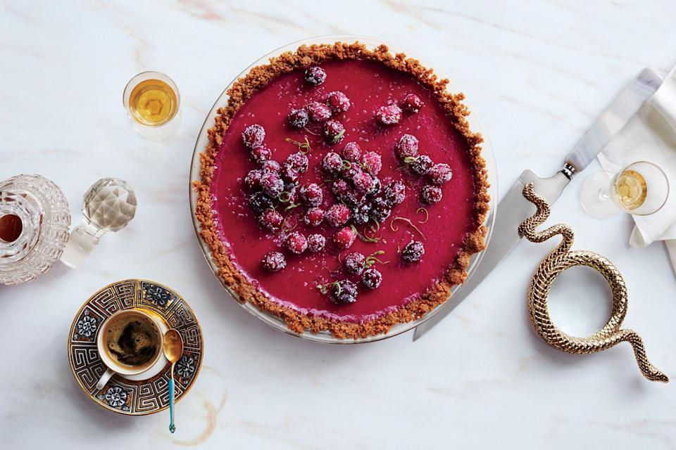 """Looking for a Thanksgiving pie recipe that's a bit more refreshing? This cranberry tart has the spirit of a Key lime pie. The contrast between the snappy press-in crust and the tart filling in this recipe makes it an easy favorite. <a href=""""https://www.epicurious.com/recipes/food/views/cranberry-lime-pie?mbid=synd_yahoo_rss"""" rel=""""nofollow noopener"""" target=""""_blank"""" data-ylk=""""slk:See recipe."""" class=""""link rapid-noclick-resp"""">See recipe.</a>"""