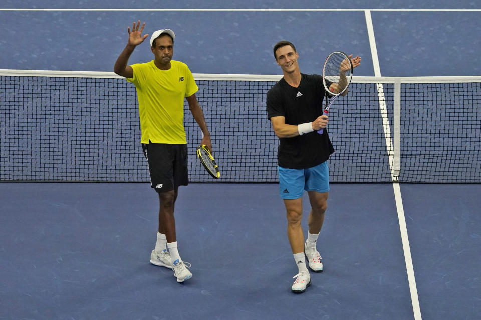 Rajeev Ram, left, of the United States, and Joe Salisbury, of Britain, celebrate after defeating Steve Johnson and Sam Querrey, both of the United States, in the men's doubles semifinals of the U.S. Open tennis tournament in New York, Thursday, Sept. 9, 2021. (AP Photo/Seth Wenig)