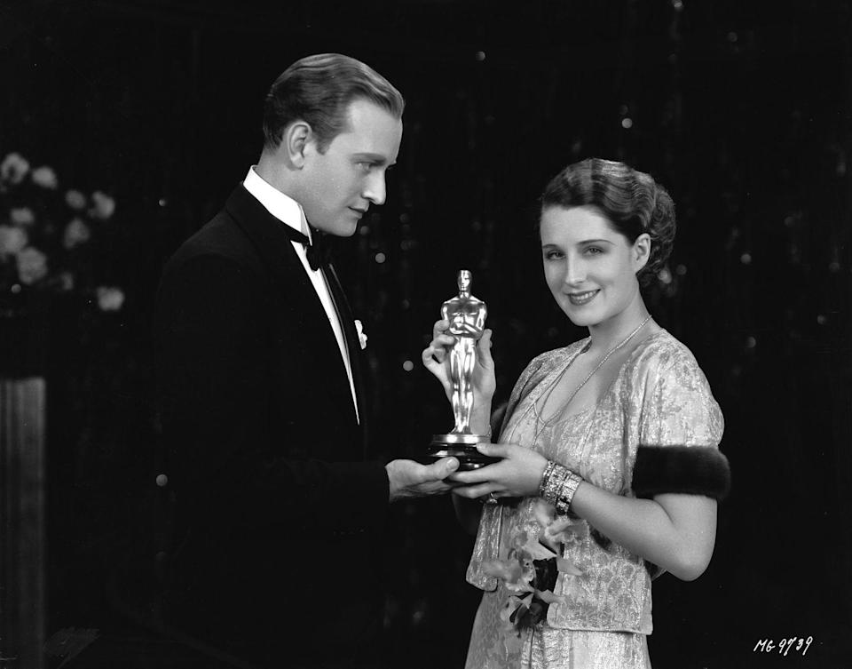 <p>Norma wore a short-sleeve jacket with textured trim over her sparkling sweetheart-neckline gown to the '31 awards. And her outfit looked even better with the Oscar she won for <em>A Free Soul</em>.</p>