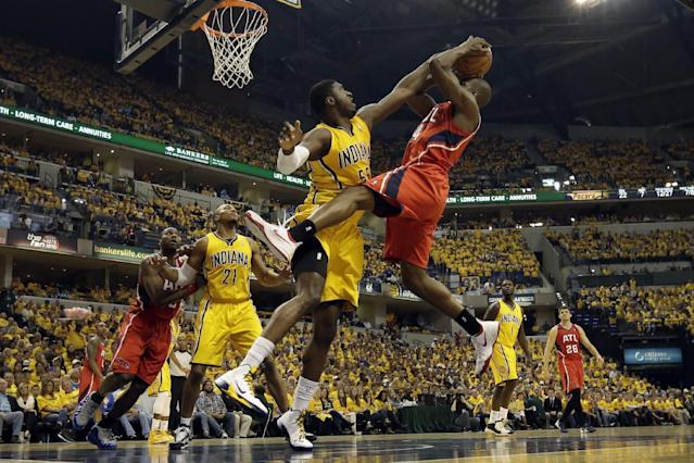 Indiana Pacers center Roy Hibbert, front left, tries to block the shot of Atlanta Hawks forward Paul Millsap during Game 7 of a first-round NBA basketball playoff series in Indianapolis, Saturday, May 3, 2014. (AP Photo/AJ Mast)