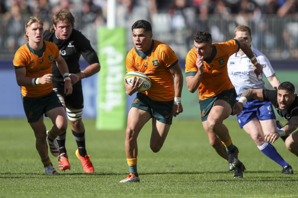 Australia's Noah Lolesio makes a runs during the Rugby Championship game between the All Blacks and the Wallabies in Perth, Australia, Sunday, Sept. 5, 2021. (AP Photo/Gary Day)