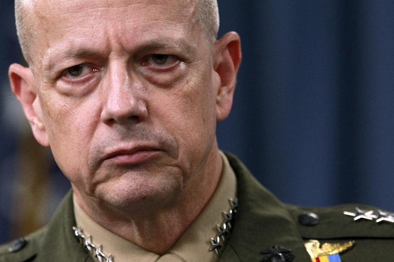 """FILE- In this March 26, 2012, file photo, Marine Gen. John Allen, the top U.S. commander in Afghanistan listens during a news conference at the Pentagon in Washington. The sex scandal that led to CIA Director David Petraeus' downfall widened Tuesday with word the top U.S. commander in Afghanistan is under investigation for thousands of alleged """"inappropriate communications"""" with another woman involved in the case.  (AP Photo/Haraz N. Ghanbari, File)"""