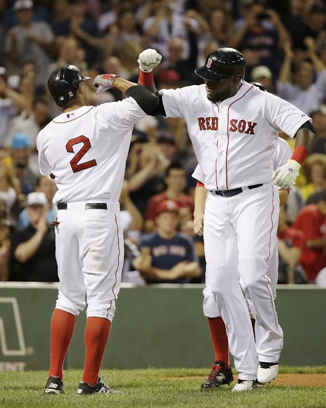 Boston Red Sox's David Ortiz, right, celebrates his three-run home run with teammate Xander Bogaerts, left, as he arrives at home plate in the fifth inning of a baseball game against the Detroit Tigers, Sunday, July 26, 2015, in Boston. (AP Photo/Steven Senne)