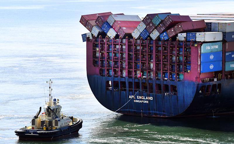 Fallen shipping containers can be seen on the Singapore-flagged container ship APL England as she docks at the Port of Brisbane. Source: AAP