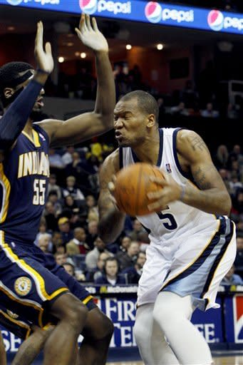 Memphis Grizzlies forward Marreese Speights (5) drives to the basket as Indiana Pacers center Roy Hibbert defends in the first half of an NBA basketball game on Friday, Feb. 10, 2012, in Memphis, Tenn. (AP Photo/Alan Spearman)